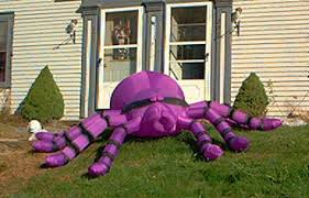 Aren't we grateful that God has blessed us with so much prosperity that we can....put giant purple spiders in our yard?